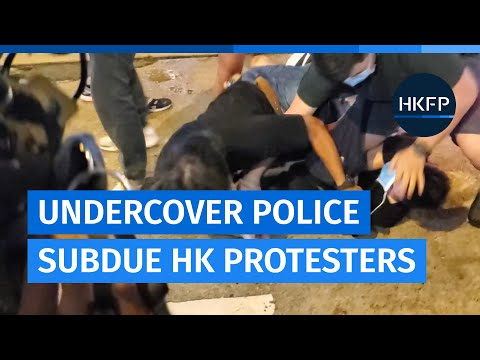 Hong Kong plainclothes officers subdue protesters in Mong Kok as they try to block road