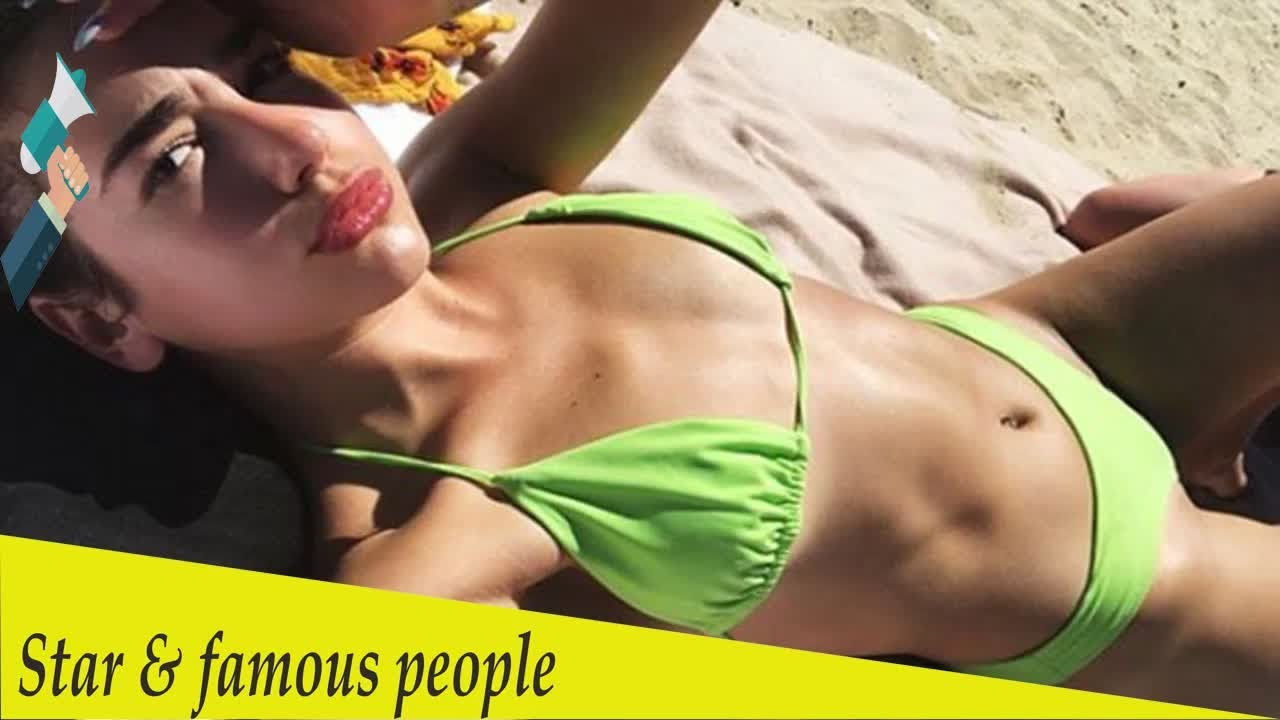 5fc8b2779d2d2 Dua Lipa leaves little to the imagination in a skimpy green bikini ...
