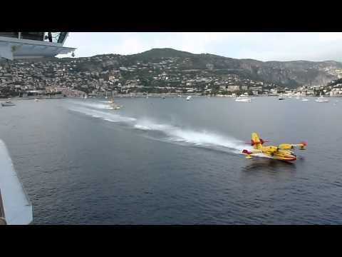 Water Bombers load up next to cruise liner