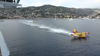 Water Bombers load up next to cruise liner Video