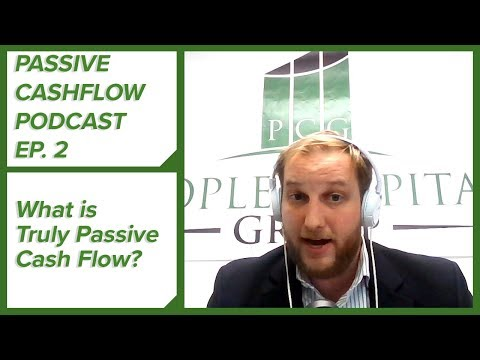 What is passive cash-flow in commercial real estate investing?