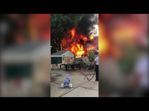Staten Island man takes fight to massive fire with garden hose
