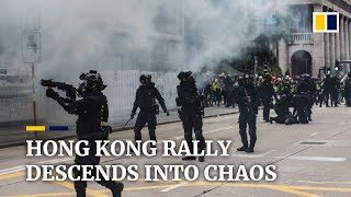 Tear gas and arrests as Hong Kong rally for universal suffrage descends into chaos