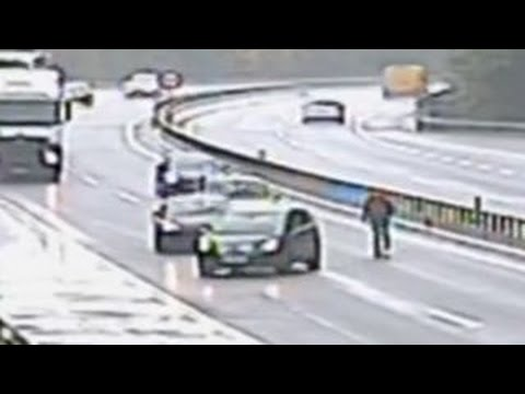 Caught on Video: See Man Stop Traffic Chasing Runaway Car Across Highway
