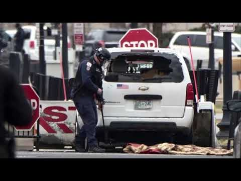 Vehicle strikes security barrier by White House, driver apprehended