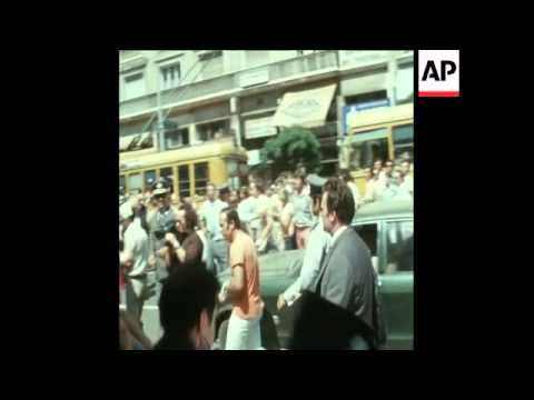 SYND 8-8-73 ATHENS AIRPORT TERRORISTS LEAVE COURT THROUGH ANGRY CROWD