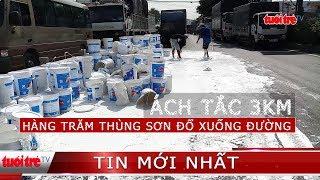⚡ NÓNG   Cả trăm thùng sơn rơi xuống đường, ách tắc giao thông nghiêm trọng