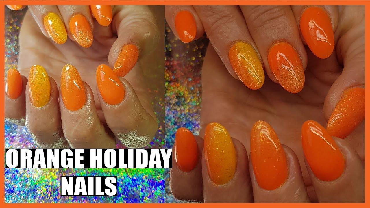 orange acrylic nails with fairy