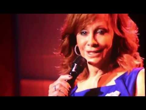 Reba sings