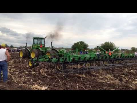 Three John Deere 830s pulling a 45 foot field cultivator