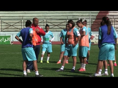 Algeria women footballers wave red card at stigma