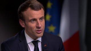"Macron: ""Aggressive"" for U.S. to leave Paris climate accord"