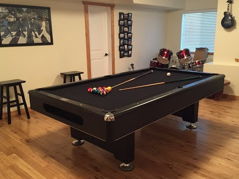 Assembly of a pool table with slates.