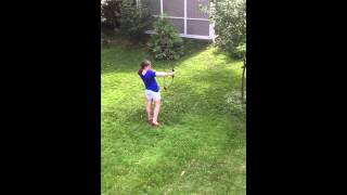 Shooting a bow and arrow with Katniss Everdeen (Sarah Kiggen)