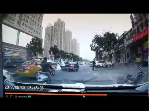 Billboard knocks over motorist in Beijing