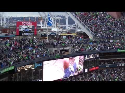 Shaun Alexander raising the 12th Man flag 9/15/13