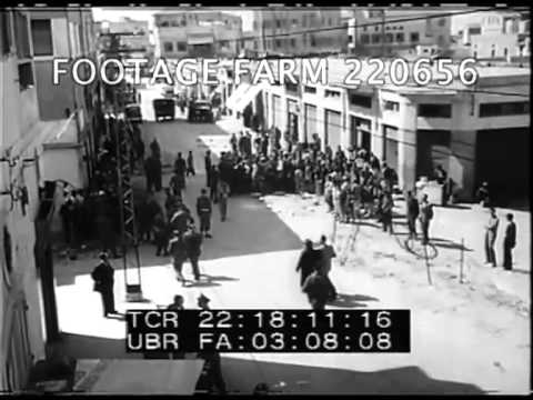 1940s, Palestine:  Jewish Refugees & Beached Boat w/ British Soldiers 220656-03.mp4 | Footage Farm