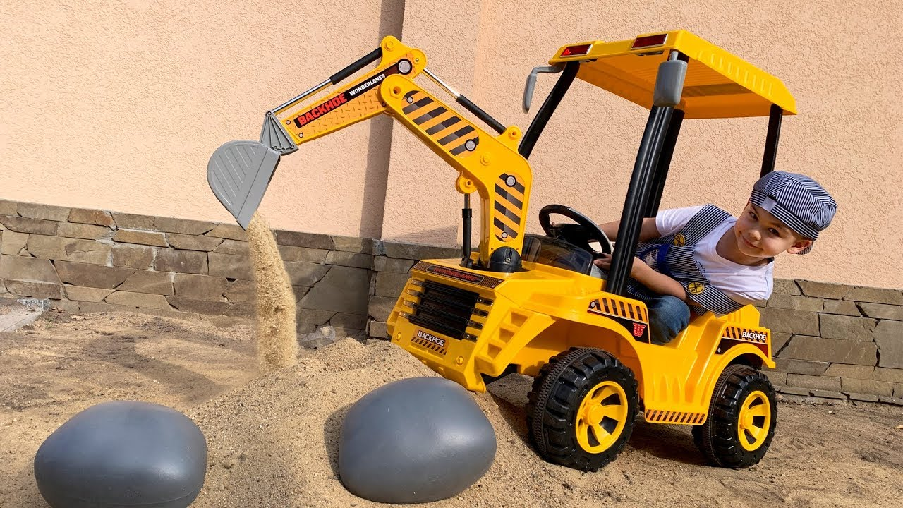 Dima unboxing power wheels tractor backhoe