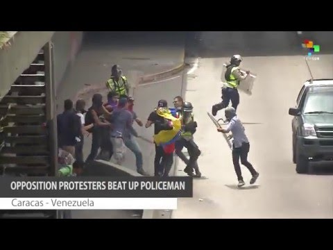 Opposition Protesters in Caracas Beat up Police Officer