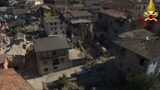 Raw: Italy's PM Tours Earthquake Scene