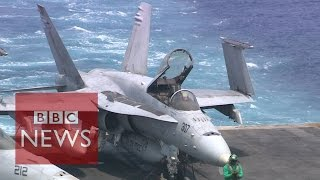 Aboard carrier launching strikes on Islamic State - BBC News