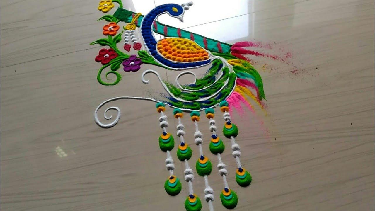 Krishna JANMASTAMI special peacock rangoli designs with flowers by jyoti #1