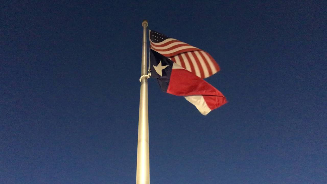 american flag and texas flag flapping in the wind free download