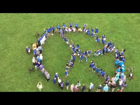 Brandywine Living Communities and YingHua International School Form Human peace sign