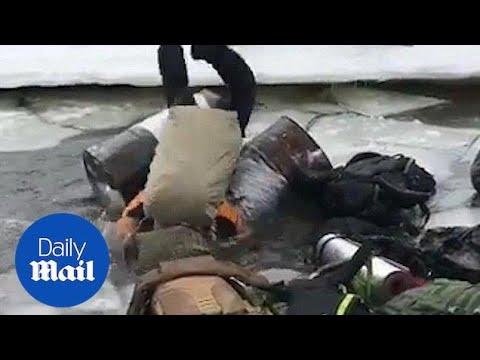 Hilarious moment men fail at crossing partially frozen river
