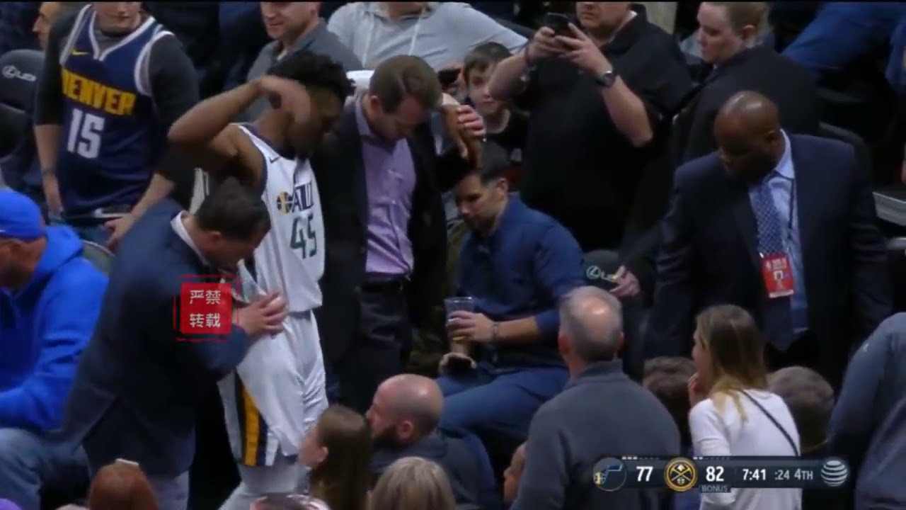 Donovan Mitchell helped off court after suffering ankle injury