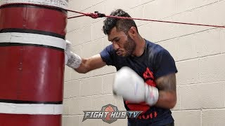 ANDREW CANCIO SMASHING THE HEAVY BAG WITH BODY COMBOS AHEAD OF WORLD TITLE DEFENSE