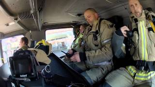 Inside a fire truck responding to a fire.