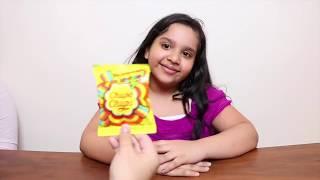 طفلة تعلم الألوان مع حلويات  !!!!