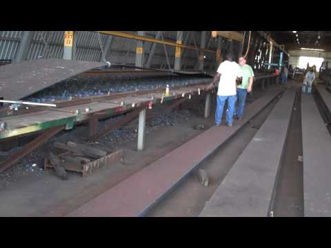 Tom with MoDOT explains steel assembly at the AFCO Steel Plant