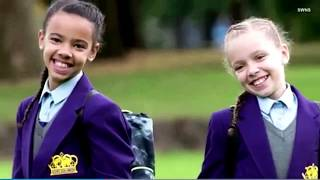 'Million-to-one' Twins, one white, one black. Marcia and Millie off to school for the first time