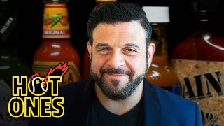 Adam Richman Impersonates Noel Gallagher While Eating Spicy Wings | Hot Ones