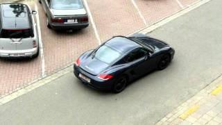 Porsche Cayman S blue on blue driving away!