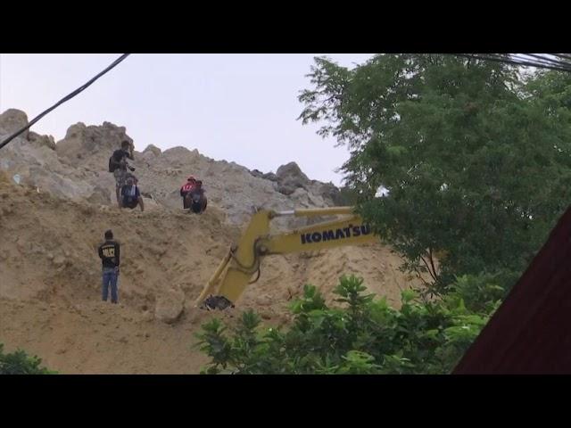 Landslide kills 21, buries houses in Philippines