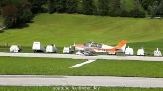 Airportspotting.Takeoff. Mountains of the Alps.Airport Sankt Johann Tirol Austria