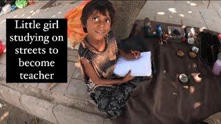 Unbelievable…Sweet little girl studying hard on streets 🥺