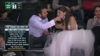 Bride Wears Gown While Eating Hamburger at Post-Wedding Hockey Game