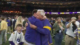 Steve Ensminger embraces son after LSU National Championship