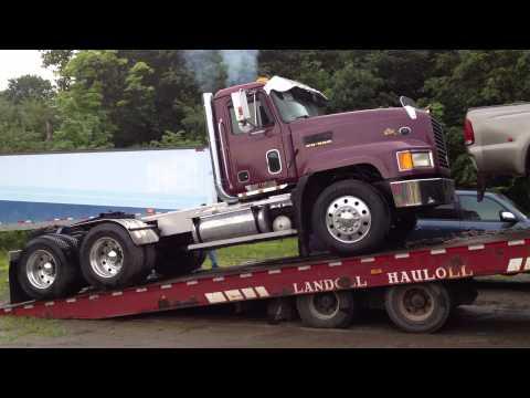 E9 V8 Mack unloading off trailer 7/3/13