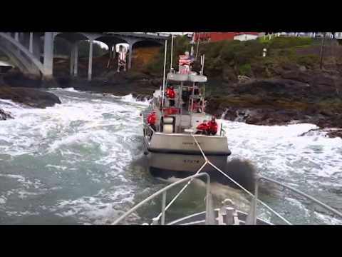 "Coast Guard Station Depoe Bay lifeboat tows another lifeboat through ""The Hole"""