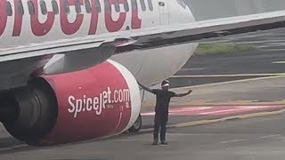 Man Runs Up To Taxiing Plane
