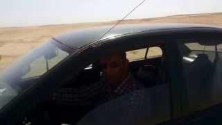 هانى عبد الرحمن بالسيارة فى التجهيز لحفر اول موقع فى قناة السويس الجديدة أغسطس 2014