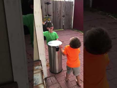 Eric Paulsen - Boys happily taking turns getting a trash can lid to the face goes viral