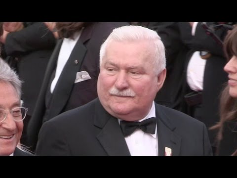 Lech Walesa and Andie MacDowell on the red carpet in Cannes