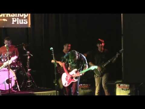 Rock ensemble performing Joe Satriani tune at Guitar Workshop Plus