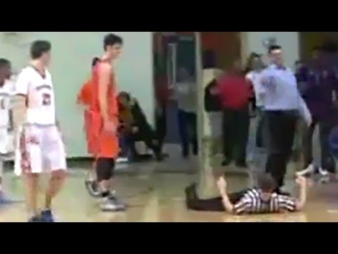 High School Basketball Coach Drops Referee With Head Butt